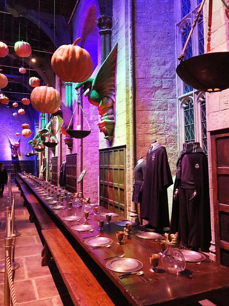 "Of all the items on diehard Harry Potter fans' bucket lists, getting the chance to walk through London's Harry Potter Studio Tour is up there next to drinking butterbeer IRL and joining Emma Watson and Daniel Radcliffe's group chat. Although the latter is likely impossible, it's easy to score tickets to the magical tour (if you can afford a ticket across the pond, that is). If it's something that you're in the process of planning, we have just one recommendation for you: go in October or November. The brilliant minds behind the studio tour's decorations have incorporated a ""Dark Arts""-theme in honor of Halloween, lasting between Oct. 1 to Nov. 12. In addition to spectacularly creepy appearances from masked Death Eaters (who lurk around nearly every corner of the tour's eerie Forbidden Forest section, and will give you at least 50 heart attacks), there are also over 100 floating pumpkins hovering in the iconic Great Hall set.       Related:                                                                                                           OMG! The Harry Potter Studio Tour Is Hosting a Halloween Feast in the Great Hall               The pumpkins, which are reminiscent of the ones featured in Harry Potter and the Sorcerer's Stone, were designed by the film series' head propmaker, Pierre Bohanna. No two floating pumpkins are alike, but all are modeled after the ones seen in Hagrid's pumpkin patch in Harry Potter and the Prisoner of Azkaban. If you work up an appetite while taking in the wondrous decorations, the prop department has also supplied each of the long, wooden tables in the Great Hall with a festive Fall feast of red apples, pastries, juice, cauldrons brimming with lollipops, and (you guessed it) more pumpkins.  As if the studio tour wasn't amazing enough already, right? We traveled to London to check out the Dark Arts theme for ourselves, and we can assure you that Harry Potter + Halloween = pure magic."