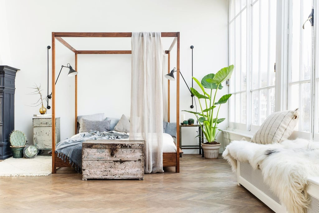 The mirror on the wall is certain that this airy, white bedroom is the fairest of all.