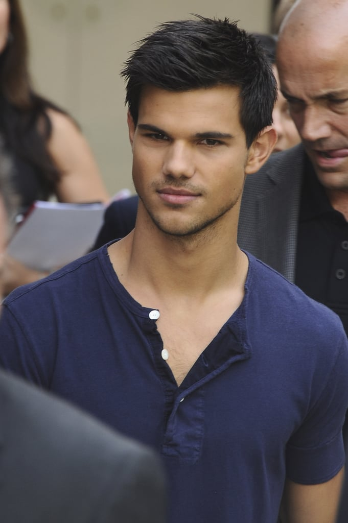 Taylor Lautner wore a blue henley shirt to the event.
