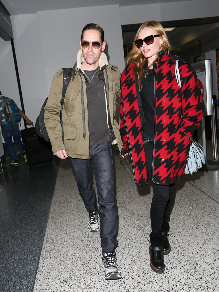This could be an ad for Coach's wool, houndstooth parka ($1,495). We're sold.