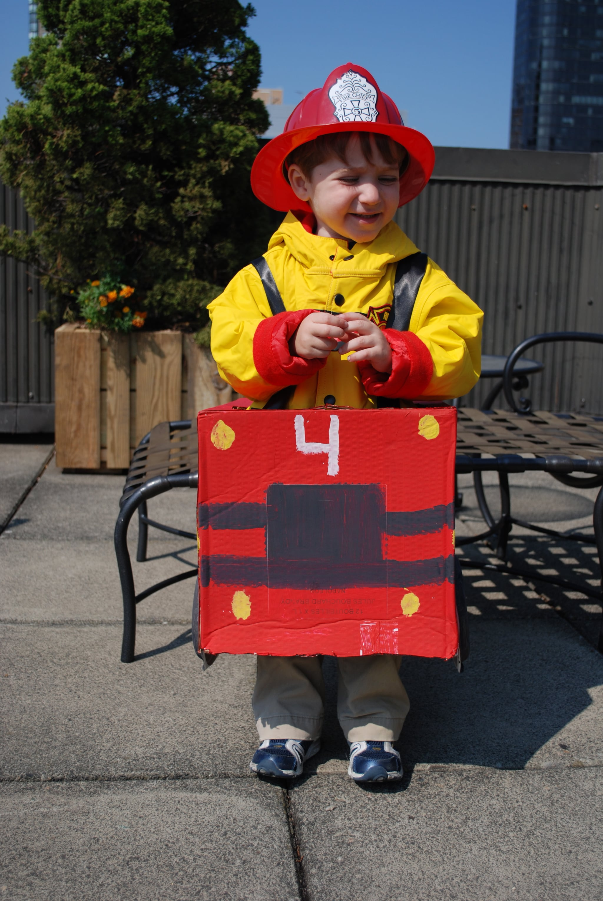 Have your child dress in his favorite fire man clothing and place the costume over his head.