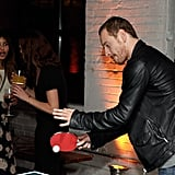 Zoe Kravitz watches Michael Fassbender play ping-pong.
