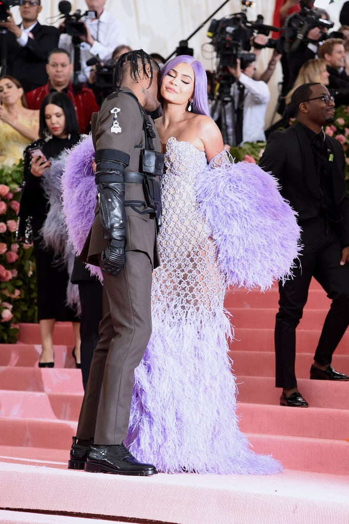 Kylie Jenner and Travis Scott turned the Met Gala into date night when they stepped out together on Monday. The couple — who recently celebrated the rapper's 28th birthday — stuck to the fashion event's camp theme as Kylie donned a lavender feathered dress and Travis opted for a military-inspired look. The Met Gala likely holds a special place in Kylie and Travis's hearts, as it's where the pair made their red carpet debut as a couple in 2018. Also in attendance were Kylie's family, including Kim Kardashian, Kanye West, Kendall, and Kris. See more of Kylie and Travis's night ahead!      Related:                                                                                                           You Might Have to Physically Pick Up Your Jaw After Seeing These Sexy Kylie Jenner Snaps