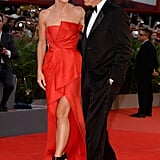 Sandra Bullock wore a red gown to hit the red carpet with George Clooney at the Venice Film Festival.