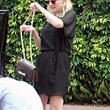 Kirsten Dunst slung her purse over her shoulder.