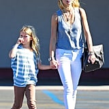 Gwyneth and Apple walked out of the store together.