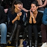 Hannah Simone and Olivia Munn both wore head-to-toe black to cheer on the Lakers in March.
