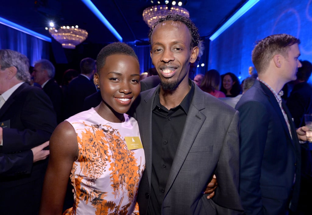 Lupita Nyong'o met up with Captain Phillips star Barkhad Abdi inside the event.
