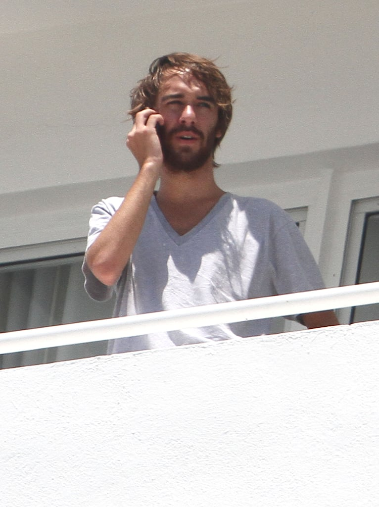 Cheyne Thomas hung out on the balcony of Miley Cyrus's Miami hotel room.