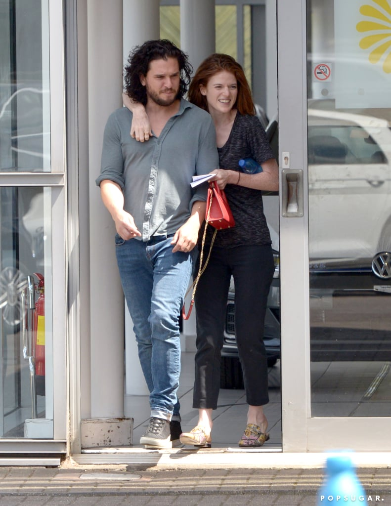 Kit Harington and Rose Leslie tied the knot in a gorgeous ceremony on June 23, and from the looks of it, they're still floating on cloud nine. On Wednesday, the newlyweds looked all loved up while doing some car shopping in London. Kit and Rose held hands as they walked through the parking lot, and at one point, Rose adorably wrapped her arm around her husband and the two shared a laugh.  It's still unclear if Kit and Rose already went on their honeymoon or if they're postponing it until Game of Thrones is officially done filming its final season. However, we did spot the pair enjoying a postwedding lunch with family and friends at Wardhill Castle in Scotland just a few days after their nuptials. Guess we'll just have to wait and see.  Related: 10 Facts You Didn't Know About Kit Harington and Rose Leslie's Wedding