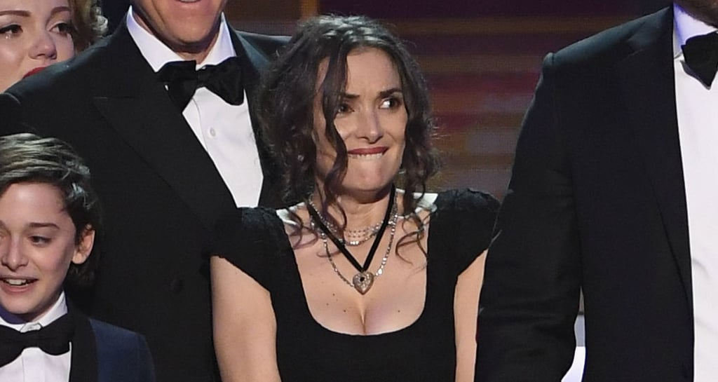 The cast of Stranger Things were already having an absolute blast at the SAG Awards on Sunday night, and their excitement kicked into overdrive when it was announced they were the lucky (and incredibly deserving) winners of the award for outstanding performance by an ensemble in a drama series.  Although everyone was hyped about the big win, leading lady Winona Ryder — who was nominated for best actress for her work in the Netflix hit — looked especially overwhelmed (and bewildered?). From the second the cast made their way up to the stage, all the way through costar David Harbour's passionate speech, she could barely handle her emotions. In other words, Winona just gave us all the reaction GIFs we'll ever need.