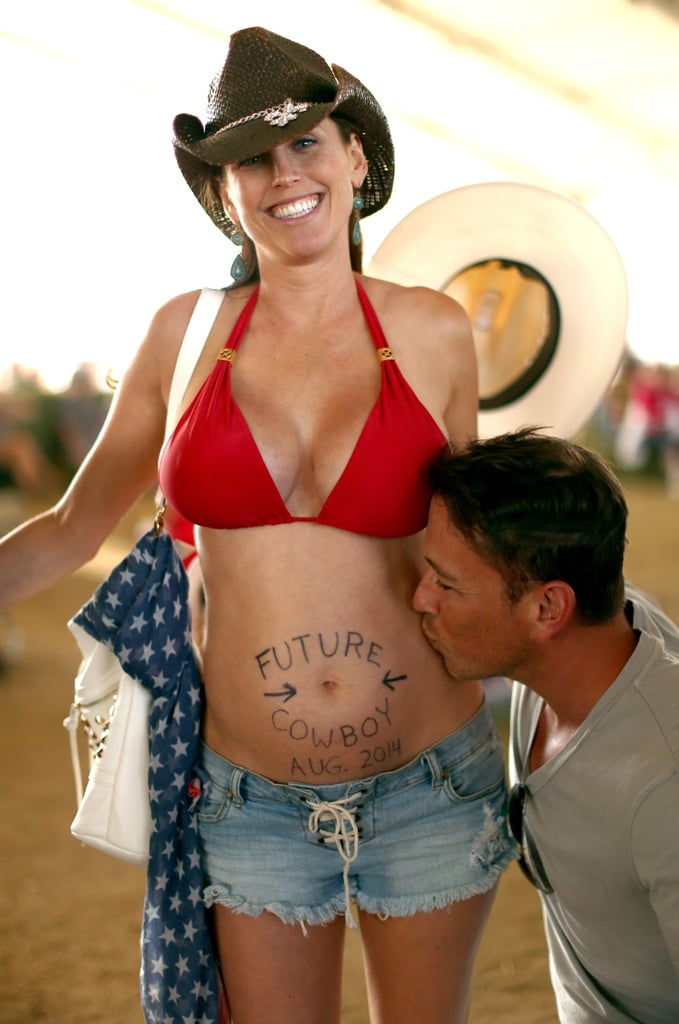 "Expectant parents showed off their ""future cowboy"" at Stagecoach in Indio, CA."