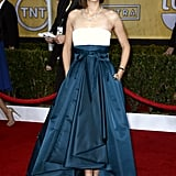 Marion Cotillard wowed in a Dior Haute Couture number with an ivory silk top and dark green skirt. She accessorized with black pointed pumps, black nail polish, and a diamond Chopard necklace.