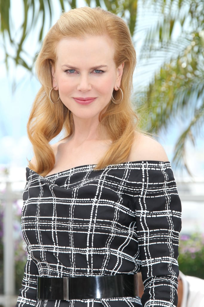 Nicole Kidman opted for a sophisticated Christian Dior sheath, paired with a sleek black belt, at the Hemingway & Gellhorn photocall.