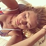 Sunbathing in a Striped Bikini
