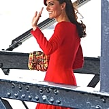 Kate waved in her red ensemble.