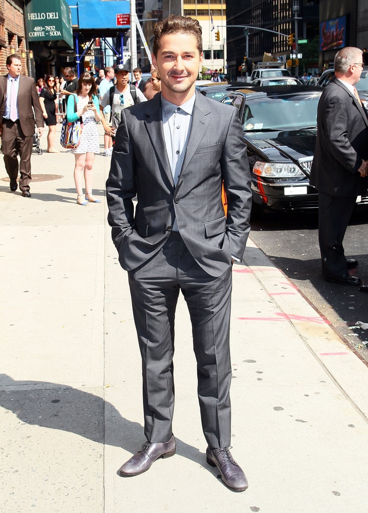 Shia LaBeouf donned a suit, but no tie, as he headed into The Late Show With David Letterman's studios today in NYC. The actor, who sported a sleek pompadour for his TV appearance, is back in the states after spending part of last week in Europe. He joined his fellow cast members for the Russian premiere of Transformers: Dark of the Moon on Wednesday before the group split up to tackle press duties in Madrid, Berlin, Paris, and London. Shia was also profiled in yesterday's Los Angeles Times and talked about both his career and his romantic life in the interview. Shia's girlfriend Karolyn Pho was one topic of conversation, and he admitted that his new love is encouraging him to be more grown-up and adventurous in life. On the big screen, though, Shia's only got eyes for Rosie Huntington-Whitley, who replaced Megan Fox in the third installment of the action franchise.