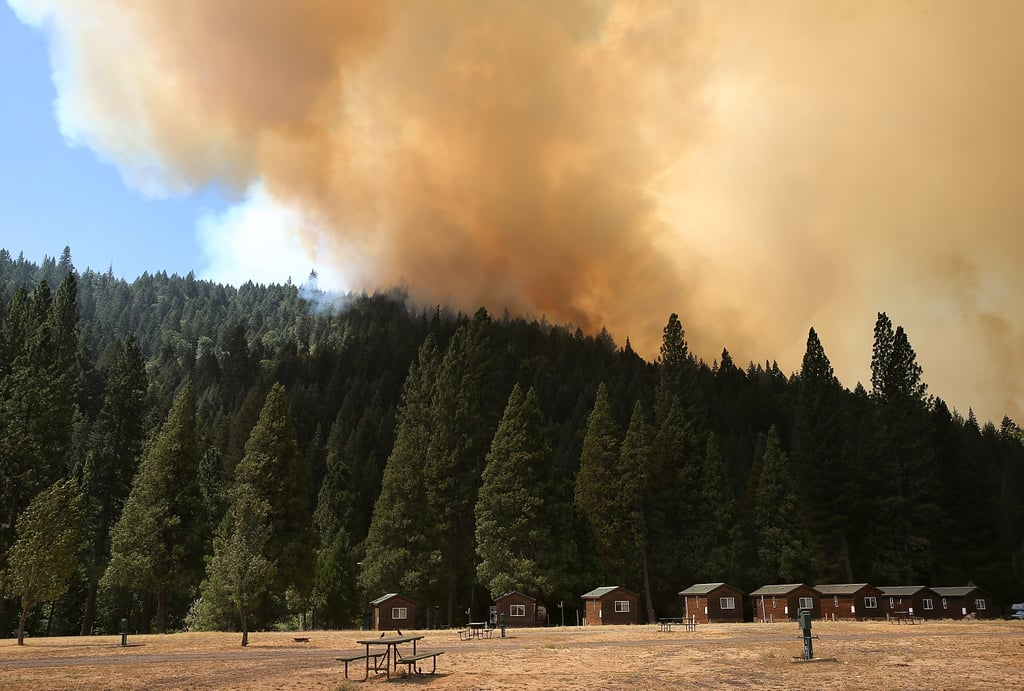 A plume of smoke rose into the sky as the Rim Fire kept burning.
