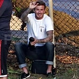 David Beckham waved hello to his sons at their soccer pratice.