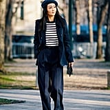 Lean into the French-girl vibe by topping off a suit and striped tee with a beret.