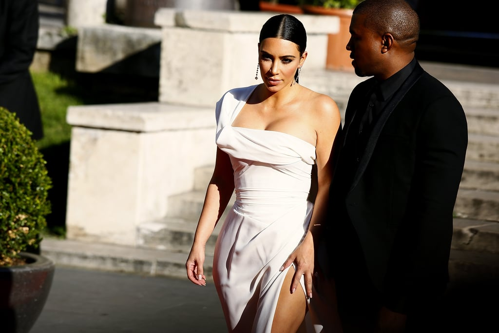 Just days ahead of their second wedding anniversary, Kim Kardashian and Kanye West headed back to Italy for a fashionable red carpet outing. On Sunday, the couple attended the premiere of La Traviata at the Teatro dell'Opera in Rome; Kim wore a stunning white one-shoulder dress, while Kanye kept things cool in all black, reminding us not only of their lavish wedding, but also their infamous Vogue cover. The classic production is headed by fashion designer Valentino Garavani, who has been a close pal of Kim's for years. Also involved in the updated lyrical opera is Sofia Coppola, who acts as director. Kim and Kanye famously tied the knot at the Forte di Belvedere in Florence, Italy, back in May 2014 and could likely be celebrating their milestone in the romantic countryside this week. Earlier in the weekend, they popped up in London for the Vogue festival, where Kim joined Charlotte Tillbury to discuss the power of makeup. Before that, she linked up with her sister Kendall Jenner at the Cannes Film Festival. Here's hoping that Kim keeps the selfies coming during her overseas excursion.