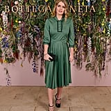 She wore a green pleated dress in November 2017.