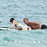 Gwen Stefani, Gavin Rossdale and their son clung onto the paddle board during a mid-Summer getaway in Miami.