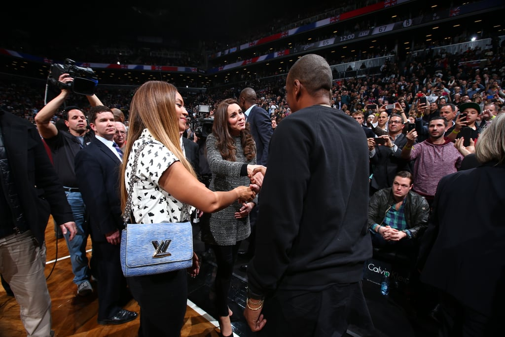 """British royalty met music royalty when the Duke and Duchess of Cambridge made their way to Brooklyn, NY, on Monday for a game date. While the Brooklyn Nets played the Cleveland Cavaliers at the Barclays Center, Prince William and Kate Middleton sat courtside — and so did Beyoncé and Jay Z, who at one point met with the royals on the court. Will and Kate also posed for pictures with global ambassador Dikembe Mutombo and NBA commissioner Adam Silver, and the couple's representative said they hope to foster a relationship between The Royal Foundation, the NBA, and United For Wildlife, Prince William's wildlife conservation foundation.  It was a night of exciting meetings for the duke and duchess, who also linked up with LeBron James. On Sunday, LeBron said he's honored to play before the royals, saying, """"People like them are only in books growing up. And to hear that they're coming to town to see me play and they want to see me do what I do best, it's a huge honor.""""  For her part, this isn't the first time Kate has shown her sporty side — the athletic royal has had plenty of active moments over the years, and she and Will were seen in the stands at Wimbledon, at the Commonwealth Games, and at the London Olympics back in 2012. The basketball date comes after a busy day for the couple; after their stylish arrival in NYC on Sunday, Prince William jetted to Washington DC to meet with President Obama while Kate spent time with local children in the Big Apple. Take a look at all the cute pictures from their Brooklyn night out, and then find out more about Will and Kate's visit to NYC!"""