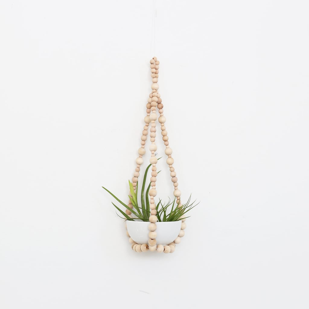 For the bohemian in your life, this Small Beaded Plant Hanger ($43) looks especially chic when mixed with modern airplants or succulent varities.