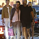 Jamie Hince and a friend were arm in arm as Kate Moss strolled behind.