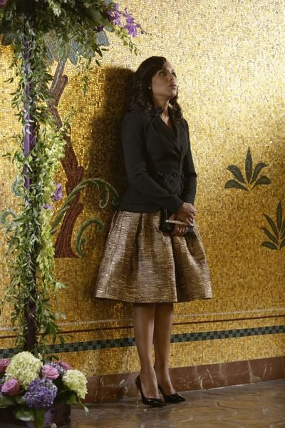 A full gold skirt is a new formal look for Olivia, too.