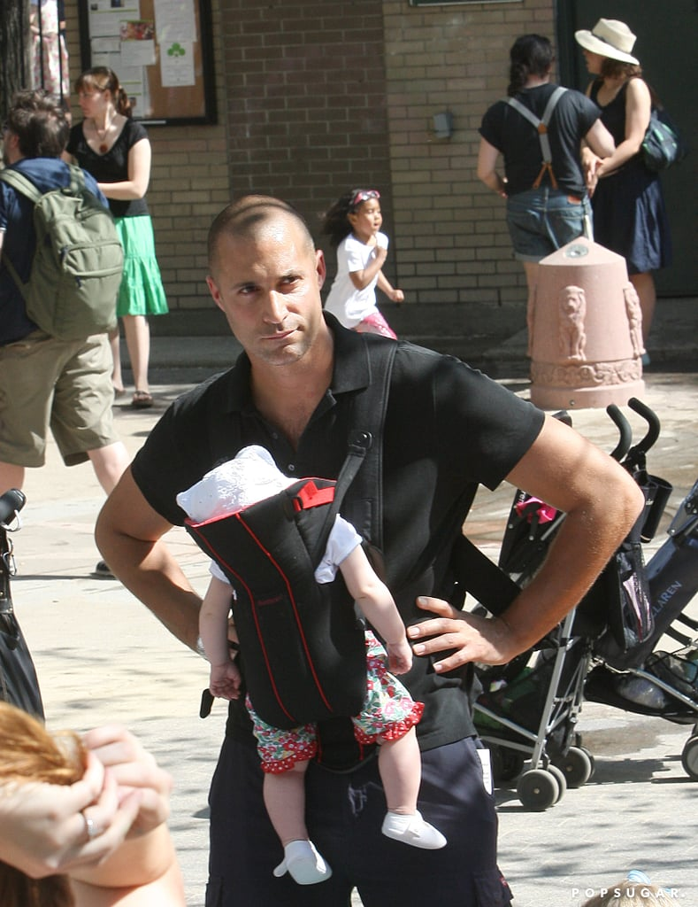 Nigel Barker kept his hands free while chasing his son through the park by wearing baby Jasmine in a BabyBjörn.