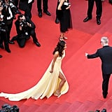Amal Clooney Made Use of the Leg Slit on Her Atelier Versace Gown as She Climbed the Stairs
