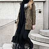 Juxtapositions like this make for real fashion statements — a sheer maxi paired with a street-chic anorak.