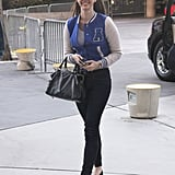 Lana Del Rey took a literal approach to sporty chic in a cool blue varsity jacket while arriving at a Lakers game in April 2012.