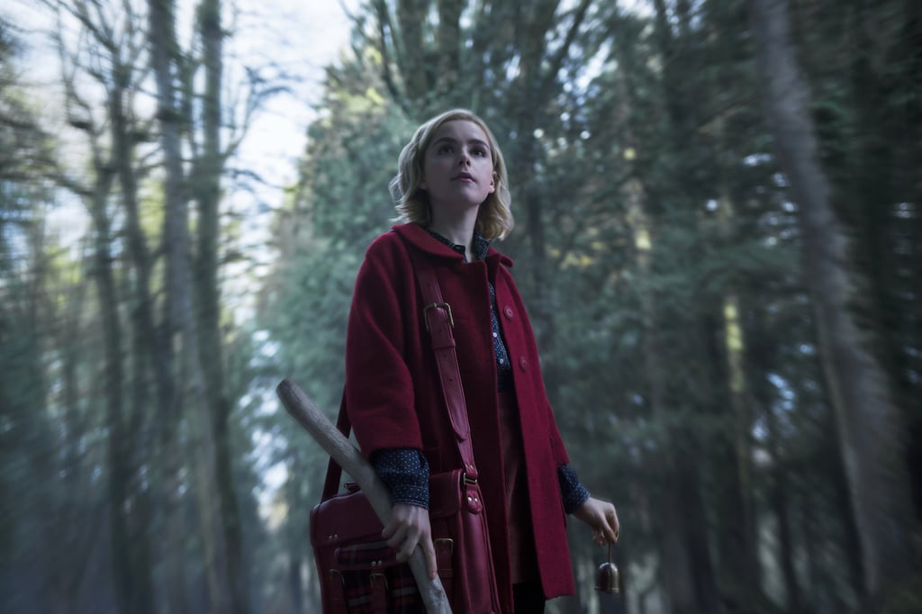 "We knew Chilling Adventures of Sabrina was going to be spooky, but we didn't imagine it was going to be this spooky. After getting a few glimpses of the cast on set over the past few months, we now have the first official look at the series. While the first image features Kiernan Shipka as the teenage witch roaming the woods, the second photo is much more sinister, as it portrays ""the dark baptism of Sabrina."" Based on these images alone, it seems pretty fitting that the first season will be dropping right around Halloween. We are so ready!"