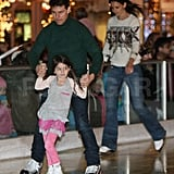 Tom Cruise and Katie Holmes ice-skating with Suri.