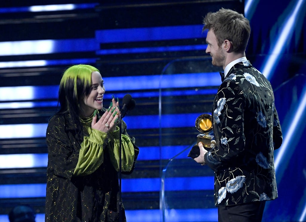 """Billie Eilish had a monumental night at the Grammys on Sunday. After becoming the youngest person to receive nominations in all four major categories — including album of the year, record of the year, song of the year, and best new artist — the 18-year-old made history yet again when she won all the aforementioned awards. She also made history as the youngest artist to receive album of the year, a record which was previously held by Taylor Swift.  During her acceptance speech for song of the year, Eilish took a moment to reflect on the special honor. """"I feel like I joke around a lot and I never take anything seriously at these kind of things, but I genuinely want to say I'm so grateful,"""" she said before the passing the mic to her brother and best friend, Finneas O'Connell. He then gave a shout-out all the aspiring musicians who are currently writing music in their bedrooms. """"You're gonna get one of these,"""" he said, holding up his Grammy. Watch her speeches from the night ahead."""