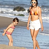 Alessandra Ambrosio sported a bikini along with daughter Anja on the beach in Malibu in July.