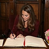 Kate Middleton signed a guest book.