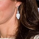 Kate's earrings are by London-based label Beaut, a concession sold at Jenny Packham's boutique. She previously wore them with a Jenny Packham gown at St James' Palace last November.