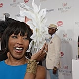Angela Bassett got a kick out of her hat during the 2014 festivities.