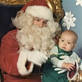 Honestly, Santa looks a bit more out of sorts than the kiddo here.