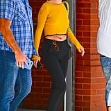 Selena Gomez Wearing Yellow Crop Top
