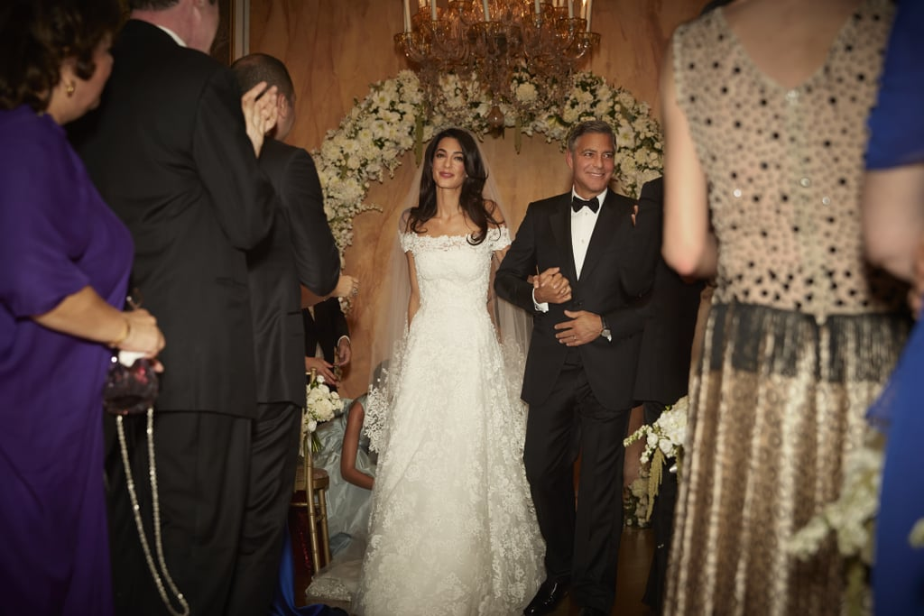 amal alamuddin and george clooney walking down the aisle