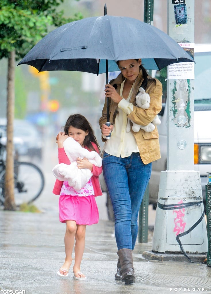 Soggy conditions didn't keep Suri Cruise and Katie Holmes cooped up inside yesterday. The pair ventured out to one of their favorite lunchtime spots, Pastis. Suri's back with Katie following a recent stay in the Hamptons with Tom Cruise. While Suri was away, Katie kept herself busy with a spin class and also landed a new role. Katie's returning to Broadway this Fall in Dead Accounts. In addition to returning to the stage, Katie's been tapped to star opposite Chace Crawford in the romantic comedy Responsible Adults and present her Holmes & Yang collection at New York Fashion Week in September.