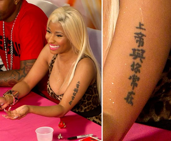 Nicki Minaj has characters running up her arm.