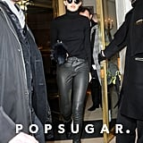Gigi went Parisian-chic to run an errand in Paris in leather skinnies, a crisp turtleneck, baseball cap, Krewe du Optic sunglasses, and booties. She finished her look with a furry accessory.