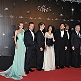 The jurors of the Cannes Film Festival lined up for a photograph at the opening night dinner.