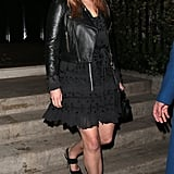 That same month, she wore them with an all-black outfit composed of a frilly dress and a cropped leather jacket.